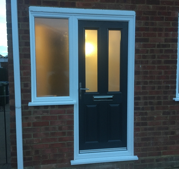 new grey composite front door with side window fitted in st neots cambs