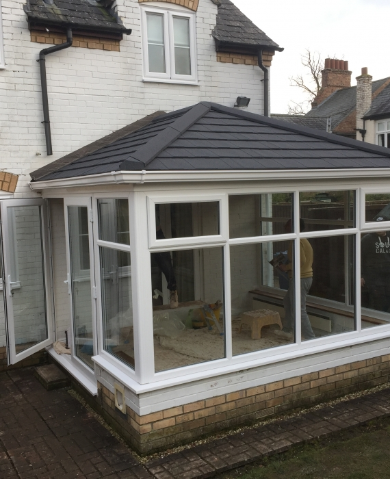before and after pictures of a new conservatory with guardian warm roof for all year round use.